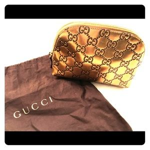 Gucci makeup leather bag (gold tone)